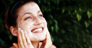 girl using face scrub for glowing skin