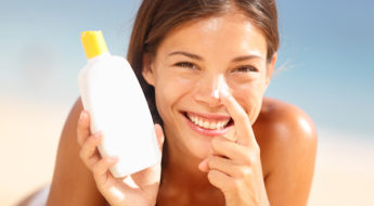 applying sunscreen for daily sun protection